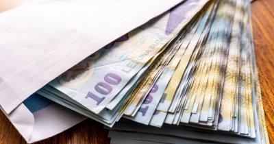 România cash-ului. Cum scot românii salariul de pe card