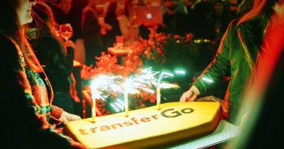 TranferGo împlinește 8 ani. Cum folosesc românii serviciul de transfer de bani